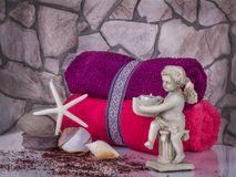 Decoration of bathroom with angel, shells and set towels on the Royalty Free Stock Images