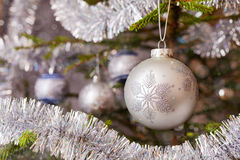 Decoration bauble on decorated Christmas tree Stock Image