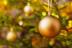 Decoration bauble on decorated Christmas tree Royalty Free Stock Photo