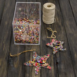 Decoration of beads star. On black table Stock Image
