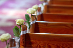 Decoration on the benches in the church before wedding ceremony Royalty Free Stock Photography