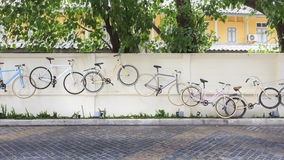 Decoration of Bicycles on Concrete wall. Decoration of Bicycles on  Concrete wall Stock Photography