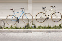Decoration of Bicycles on Concrete wall. Stock Image