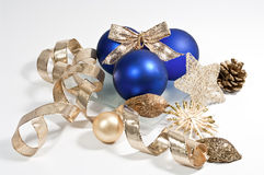 Decoration in blue and gold. Christmas decoration with three blue christmas tree balls Stock Photo