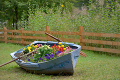 Decoration boat with flowers Stock Photo