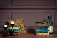 Decoration of books, candles and pillows cells Stock Photo