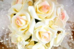 Decoration of a bridal bouquet from roses close up. Indoors. Horizontal format. Color. Photo Stock Photos