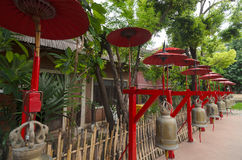 Decoration at the Buddhist temple: bells under red umbrellas. Interesting Decoration at the Buddhist temple: bells under red umbrellas Royalty Free Stock Photos