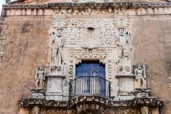 Decoration of Casa de Montejo in Merida, Mexico. Triumphant conquistadors staying on heads of barbar. S royalty free stock images