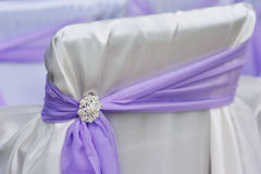 Decoration chair purple bow brooch.  Royalty Free Stock Photos