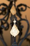 Decoration on the chandelier. A decoration piece on the chandelier Royalty Free Stock Photo