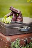 Decoration for child party in vintage style. Vintage decorations: old boots and suitcases with blooming spring flowers. Spring time in a park. Decoration for Royalty Free Stock Images