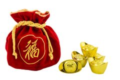 Decoration of chinese gold ingots and Red fabric or silk bag is. Chinese new year ornament Decoration of chinese gold ingots and Red fabric or silk bag isolated Stock Photo