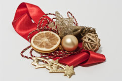Decoration for christmas. Christmas decoration with ribbons, sphere and a dried orange Royalty Free Stock Photo