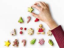 Decoration Christmas Decor Ornament Season. Hand decorating cookies for christmas Royalty Free Stock Photo