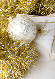 Decoration Christmas New Year silver ornament ball. On a shiny golden background with fabric napkin stock image