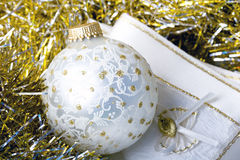 Decoration Christmas New Year silver ornament ball. On a shiny golden background with fabric napkin close up royalty free stock photography