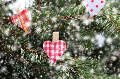 Decoration with christmas red hearts and snowflakes Royalty Free Stock Photos