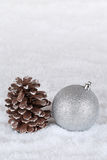 Decoration with christmas tree ball, snow and copyspace Stock Photo