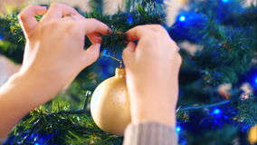 Decoration of the Christmas tree with balls stock footage