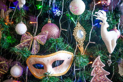Decoration on a Christmas tree in the form of carnival mask Royalty Free Stock Photos