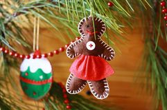 Decoration on a Christmas tree in the form of the gingerbread man Stock Photos