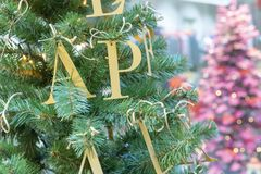 Decoration on the Christmas tree in the form of gold letters stock images