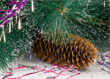 Decoration for the Christmas tree is a pine cone. Royalty Free Stock Photography