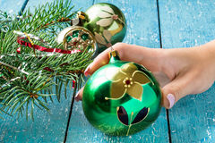 Decoration for Christmas tree, vintage ball in a female hand Royalty Free Stock Photo