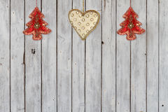 Decoration with Christmas Trees and Christmas Heart Velvet Ornaments. Decoration with two Christmas tree ornaments and one Christmas heart ornament made of royalty free stock image