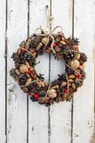 Decoration christmas wreath on white rusty wooden board backround, natural wreath, vertical Stock Images