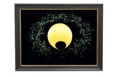 Decoration composed of black frame and light source. Decoration composed of black picture frame and different light sources stock photo