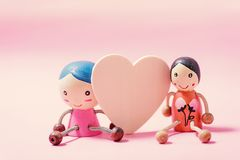 Decoration couple doll and heart on pink background Stock Image