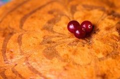 Decoration cranberry homemade cake Zebra. Home decoration sponge cake with three cranberries Stock Images