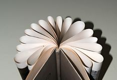 Sheets of books stored in the shape of a fan Stock Photo