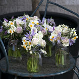 Decoration of dining table. bouquet of white narcissus in vase o Stock Photos
