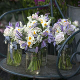 Decoration of dining table. bouquet of white narcissus in vase o Royalty Free Stock Images