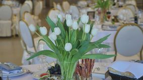 Decoration of the dining table for wedding. White tulip. stock footage