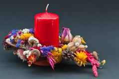 Decoration of  dry flowers with a red candle Stock Photo