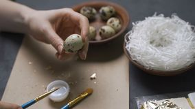 Decoration of Easter eggs with gold foil.  stock video footage