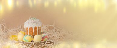 Easter nature holiday background with eggs, Easter cake. Easter bokeh golden shine light background. Decoration with eggs and Easter cake. Easter vintage style Royalty Free Stock Images