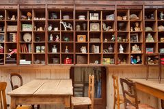 Decoration elements of vintage cafe with wooden tables and retro toys and souvenirs Stock Images