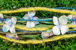 Decoration of fabric flowers and wool threads Royalty Free Stock Photos
