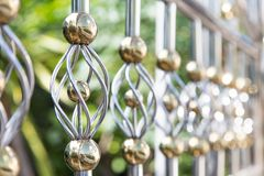 Decoration fence from alloy in gold and silver colour. Close up decoration fence from alloy in gold and silver colour Stock Image