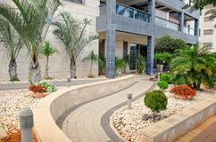 Decoration and final landscaping of residential building adjacent territory. Ness Ziona, Israel-May 21, 2017: Modern and stylish decoration of the passage with stock photo