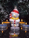 Decoration for fir tree and candles. On black background Royalty Free Stock Images