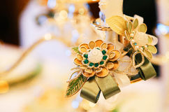Decoration of flower accessories on the table. On the table Decorations of golden flower accessories decorations Royalty Free Stock Photo