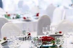 Decoration flower arrangement rose. Decoration flower arrangement red rose serviette white tablecloth Stock Photography