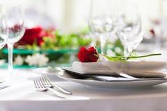 Decoration flower arrangement rose. Decoration flower arrangement red rose serviette white tablecloth Royalty Free Stock Image