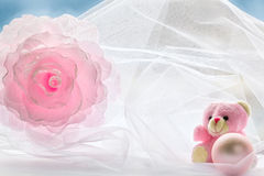 Decoration flower, teddy bear and a ball on a background of a wi Stock Images